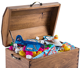 Wooden chest full of dental themed toys from Toys in a Box