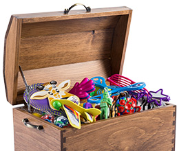 Wooden chest full of premium toys from Toys in a Box